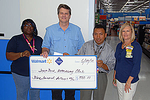 Tony Wiese accepting contribution from Walmart Management Team
