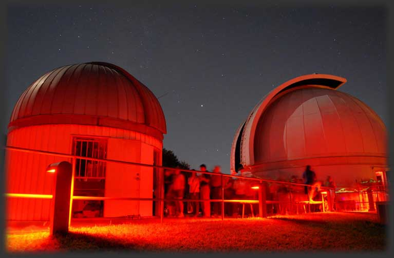 Visitors lined up at the East Dome of the George Observatory (left). Main Research Dome is pictured on the right.
